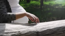Hand Of Pregnant Woman With Fingers Simulates A Kid Walking On Lying Log.