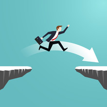 Businessman Jumping Over Chasm...