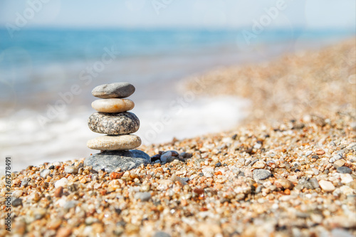 Poster de jardin Zen pierres a sable Balance of stones on the beach, sunny day