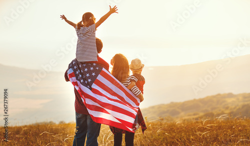 happy family with flag of america USA at sunset outdoors. - 267379094