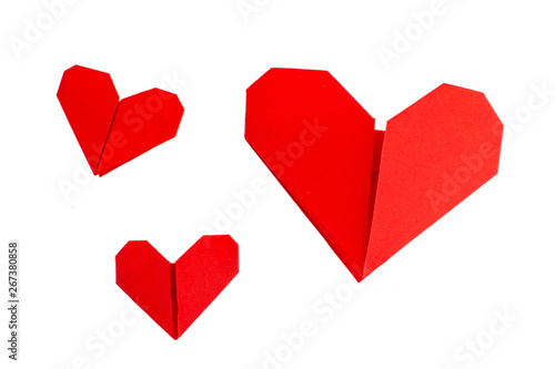 Fototapeta  Red origami hearts isolated on white