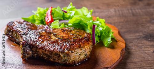 Valokuva  Pork Loin chops marinated meat Steak with vegetables slad on wooden table backgr