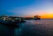 Leinwanddruck Bild SALVADOR, BAHIA, BRAZIL: Beautiful Sunset view in the port. Ships, ferry and sea.