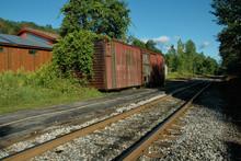 Abandoned Railway Boxcar On Siding, Rail Tracks And Trees