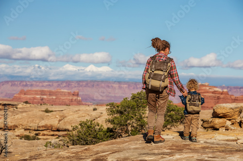 Fotografie, Obraz  Hiker with boy in Canyonlands National park, needles in the sky, in Utah, USA