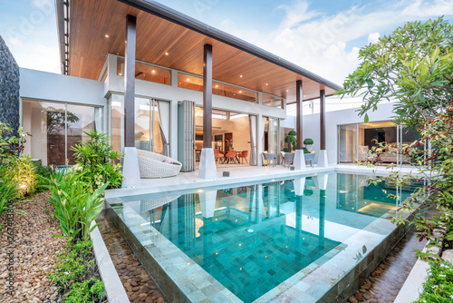 Fototapeta home or house building Exterior and interior design showing tropical pool villa with green garden and bedroom obraz