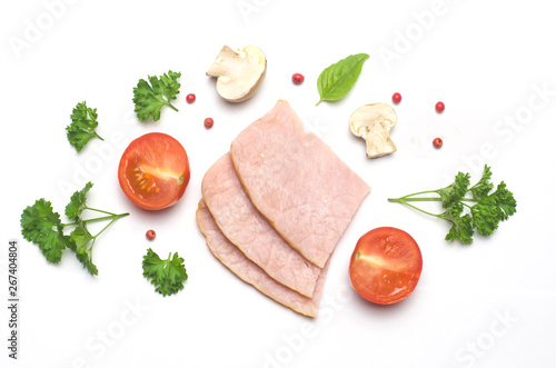 Fototapeta slices of pork and sliced tomato and mushrooms champignon next parsley and red pepper peas on white background obraz