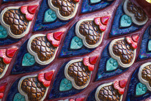 Close Up A Surface Of Naga Or Serpent Scales Stucco Pattern At Thai Buddhist Temple.