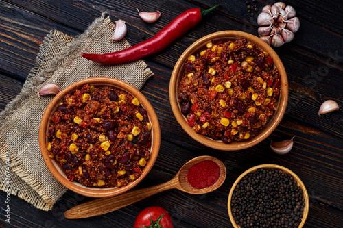 Printed kitchen splashbacks Spices Mexican quinoa warm salad, chili, vegetarian food on dark wood background. Top View.
