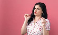 Disgusted Face Expression With Young Woman On A Solid Background