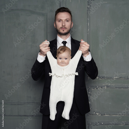 Spoed Foto op Canvas womenART Young father with beautiful little baby in his arms.