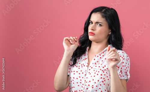 Disgusted face expression with young woman on a solid background Canvas-taulu