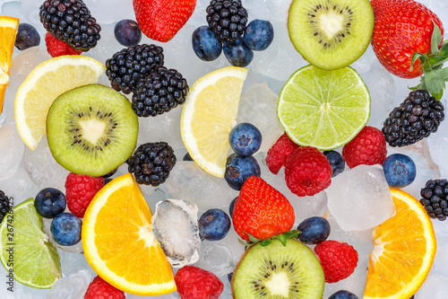 Fototapety, obrazy: Fruits berry food background oranges strawberries ice cubes fresh fruit