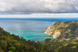 Coastal landscape with mountains and valleys on a spring day. View over the Ligurian Sea, from the red hiking path from Vernazza towards Monterosso in Cinque Terre, Italy.