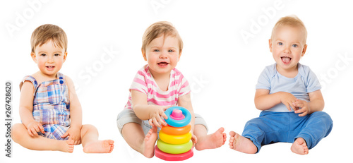Baby Kids Sitting on White, Beautiful Toddler Children with Toy, one year old - 267428620