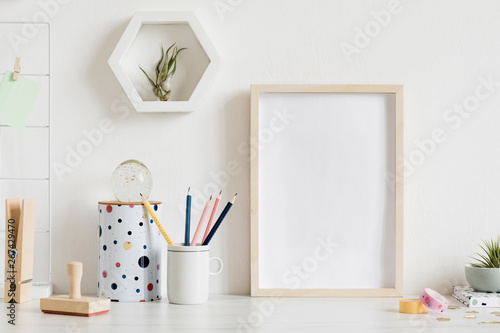 Modern and stylish home interior with wooden mock up poster frame, design office accessories, tapes, supplies, notes, memo sticks, air plants Billede på lærred