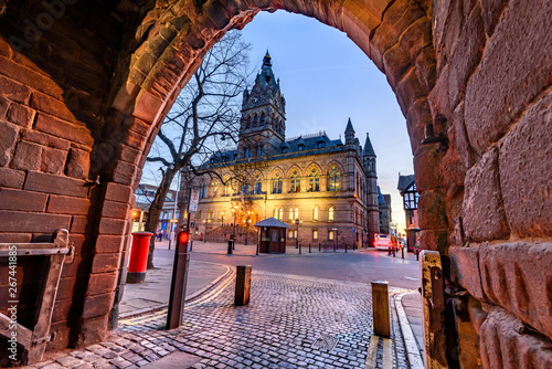Fotografia The grey and red sandstone, Gothic style Town Hall with its tower and spire of Chester city, UK