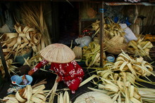 Craftsmen When Making Caping Called Tanggui Traditional Banjar Hat, Which Is Made Of Nipah Leaves And Is Commonly Used To Avoid The Sun And Rain, Banjarmasin / South Kalimantan, May 8, 2019