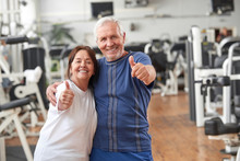 Senior Couple Giving Thumbs Up At Gym. Happy Couple Of Seniors Gesturing Thumbs Up At Fitness Center. People And Healthy Lifestyle Concept.