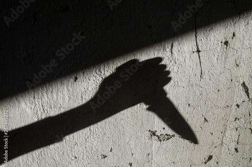 Obraz na płótnie Shadow of the hand holding a knife