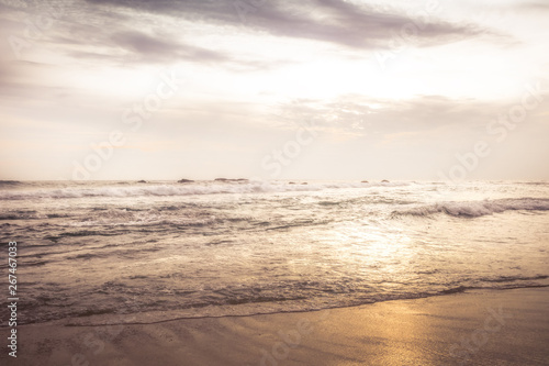 Sea beach surf waves landscape at sunset with dramatic sunset sky vintage style Canvas Print