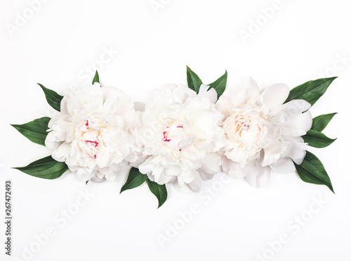 Fototapety, obrazy: Three white peony flowers and leaves on white background. Top view. Flat lay.