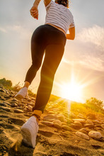 Young Fitness Woman Jogging At Sunrise/sunset Beach