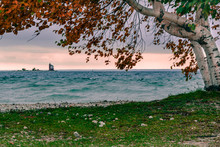 A Windy Fall Day On Mackinac Island, Looking Out At Round Island Lighthouse, With A Little Bit Of Sunset Color In The Sky.  The  Mackinac Straights And Lake Huron Were A Little Bit Rough.