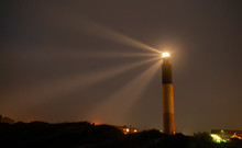 Oak Island Lighthouse Beams Into The Seafoam At Fort Caswell