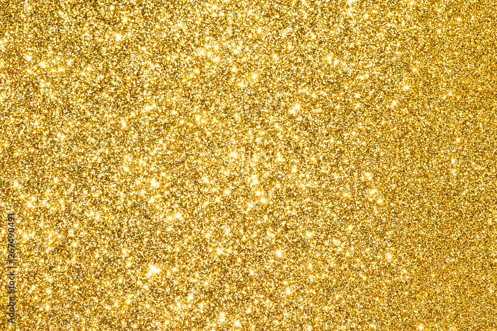 Fototapeta sparkles of golden glitter abstract background