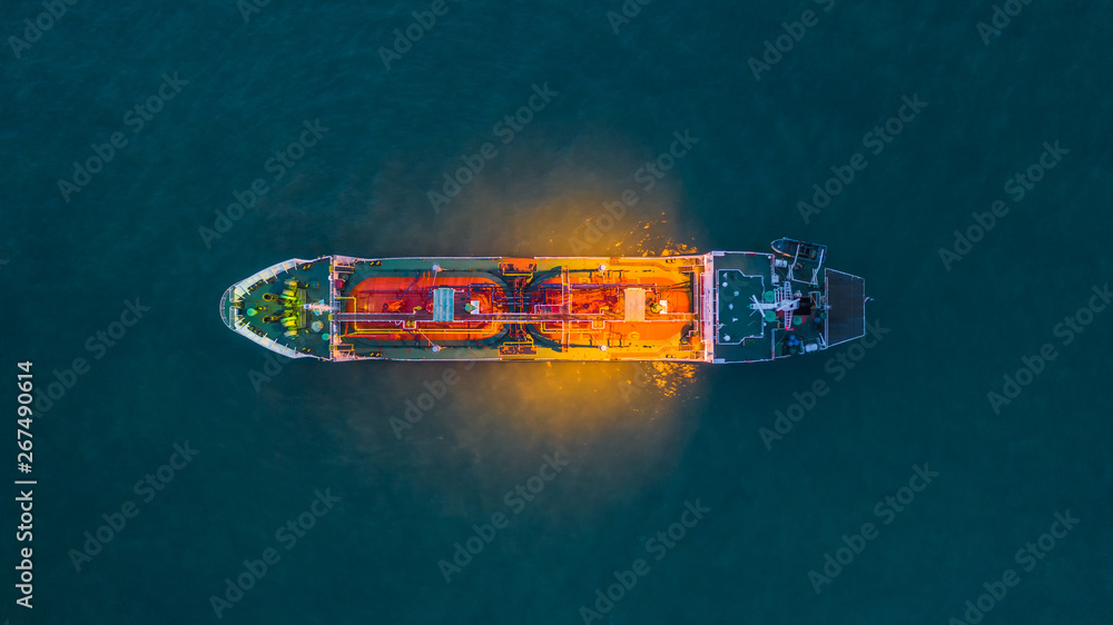Fototapety, obrazy: Aerial view oil and gas chemical tanker in open sea at night, Refinery Industry cargo ship.