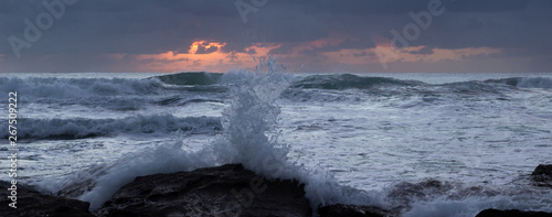 Printed kitchen splashbacks Cappuccino moody sunrise with waves and rocks
