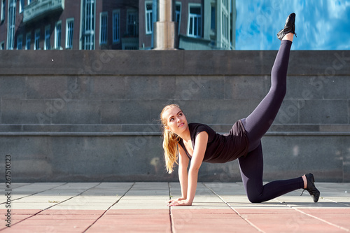 obraz lub plakat Stretching fit or dancer or fitness woman doing exercise