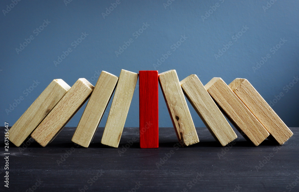 Fototapeta Successful leadership in business concept. Red and white wooden blocks.