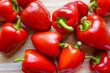 Leinwandbild Motiv Fresh red pepper over wooden background