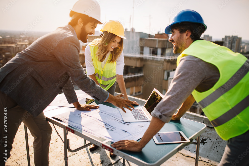 Fototapeta Architects, business manager and engineer meeting project at building site