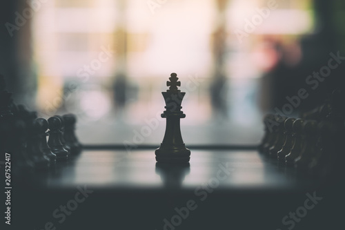 Closeup image of a silver and golden color chess set on chessboard Wallpaper Mural