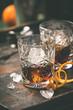 Leinwandbild Motiv Alcoholic cocktail  with orange peel and ice