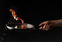 Cooking Bacon On A Griddle, On A Black Background