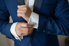 Close-up Shot Of Hands Of Young White Caucasian Male In Black Tie, Fixing His Sleeve, Sign Of Sprezzatura And Elegance. Groom, Or Sophisticated Businessman, Or Millennial Male Model Getting Ready.