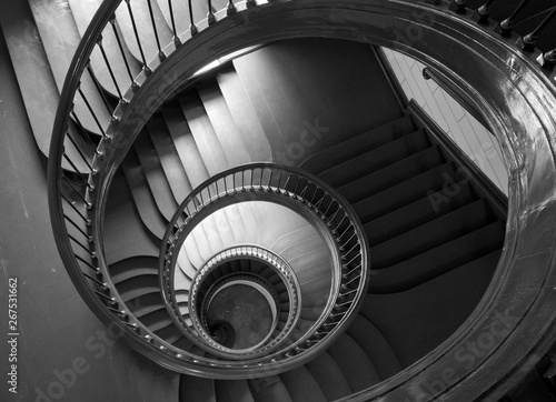 Antique spiral staircase in black and white.
