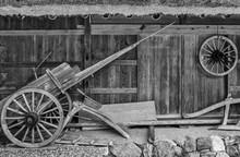 Old Wooden Wheelbarrow In Farm...