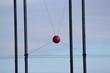 red ball between metal posts