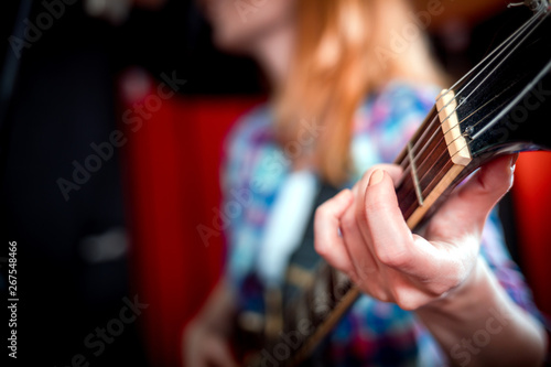 Female singer with electric guitar recording a song in studio - 267548466