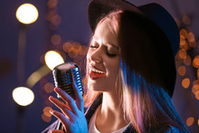 Beautiful Female Singer With Microphone On Stage