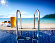 canvas print picture - Fresh cold beer and swimming pool. Sea and beach landscape.