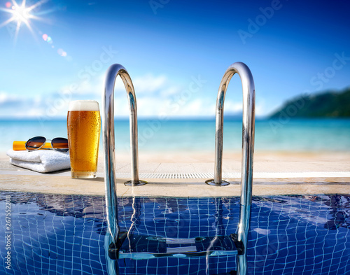 Tuinposter Europa Fresh cold beer and swimming pool. Sea and beach landscape.