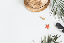 Summer Composition. Tropical Palm Leaves, Hat On Gray Background. Summer Concept. Flat Lay, Top View, Copy Space