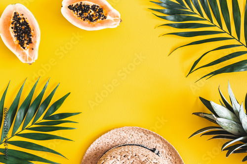 Papiers peints Fleur Summer composition. Tropical palm leaves, hat, fruits on yellow background. Summer concept. Flat lay, top view, copy space