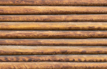 Background With Wooden Texture Of The Wall Of The Hut With Beige Round Logs